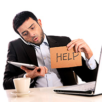 A businessman holding up a 'help' sign
